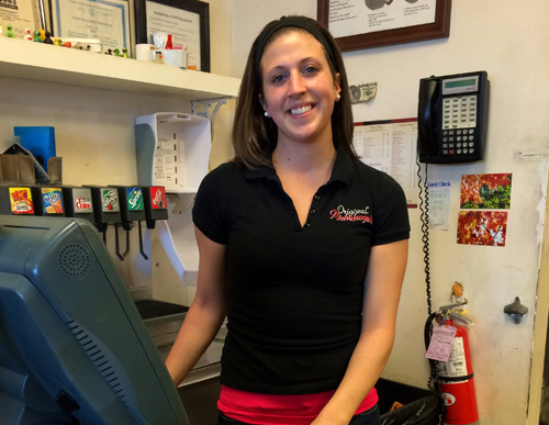 RACHEL YOUNG PHOTO | Server Rebekah Desimone behind the counter at Michelangelo's Pizzeria in Mattituck Feb. 4.