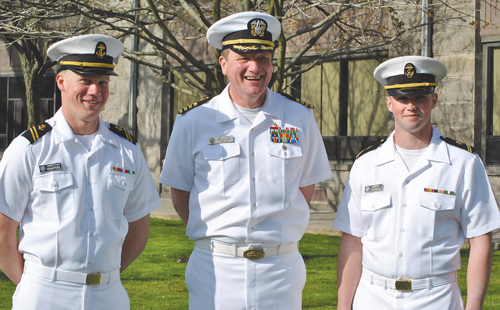 COURTESY PHOTO | Midshipmen Timothy Winters (left) and John Dunne have been appointed officers of the Naval Reserve Officers Training Corps. At center, Captain Matthew Loughlin, USN.