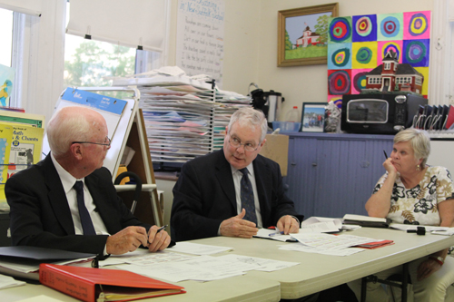 New Suffolk Elementary School principal tk, center, discussing the district's new policy of releasing public documents at Tuesday's meeting. (Credit: Jen Nuzzo)