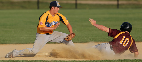 North Fork second baseman Kyle Colletta tags out Riverhead's Tyler Osik, who tried to steal in the seventh inning. (Credit: Daniel De Mato)
