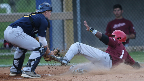 North Fork catcher Chris Gaffney tagging out Montauk's Khalil Denson, who was thrown out on a throw by left fielder Austin Miller in the first inning. (Credit: Garret Meade)