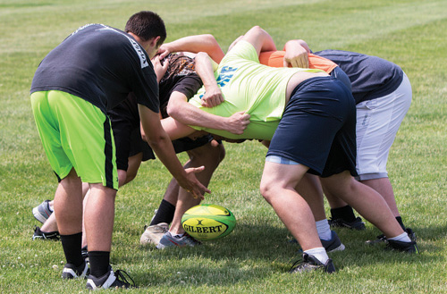 North Fork Rugby Club players during a scrum at practice. (Credit: Katharine Schroeder)