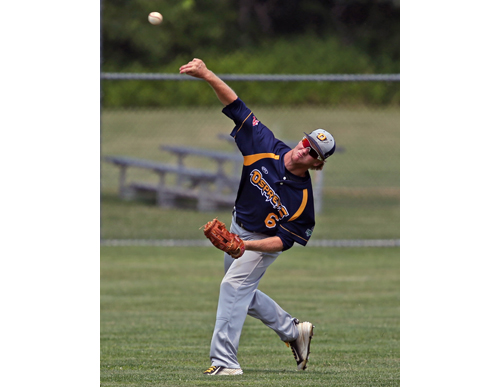 North Fork center fielder Tyler Houston making a throw home to complete a double play during Thursday's game against Sag Harbor. (Credit: Daniel De Mato)