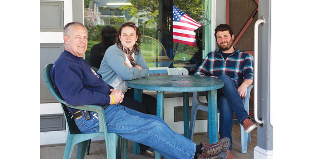 KATHARINE SCHROEDER PHOTO | Orient Country Store's former owner Linton Duell, left, with new owners Miriam Foster and Grayson Murphy on Thursday.