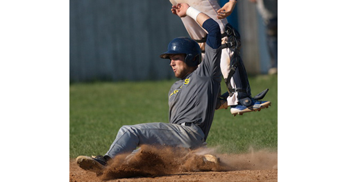 Penn Murfee slides home for North Fork's first and only run in Game 1 of its semifinal series against Southampton. (Credit: Garret Meade)