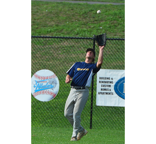 ROBERT O'ROURK PHOTO | North Fork right fielder Ryan Solberg making a catch for a long out.