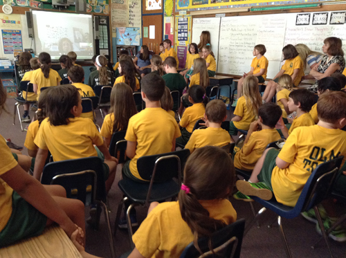Our Lady of Mercy students talking with author tk. (Credit: Courtesy)
