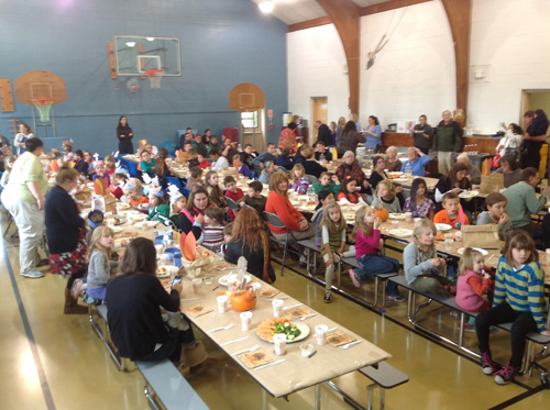 COURTESY PHOTO | Oysterponds students enjoying a Thanksgiving feast on Tuesday.