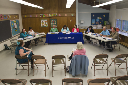 here were two audience members at Tuesday night's Oysterponds school board meeting in Orient. Most Board of Education meetings on the North Fork have low turnouts. (Credit: Paul Squire, file)