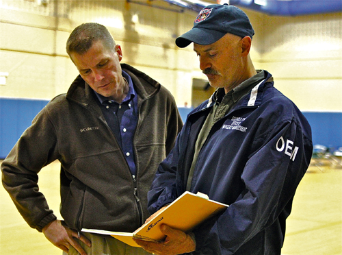 JENNIFER GUSTAVSON FILE PHOTO | Supervisor Scott Russell confers with town emergency coordinator Lloyd Reisenberg at the Mattituck High School storm shelter during Hurricane Sandy.