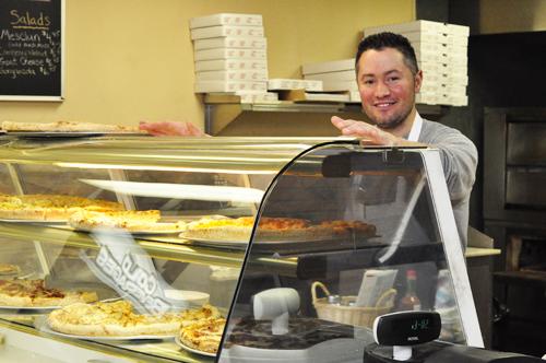 GIANNA VOLPE PHOTO     Joe Pagano, Jr. has seen plenty of familiar faces at the new Southold location for Pagano's Pizza.