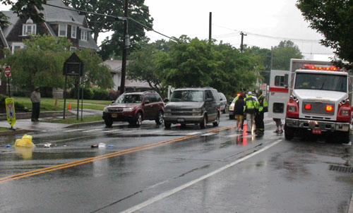 PAUL SQUIRE PHOTO | Southold police are investigating the scene of a crash on Main Road in Cutchogue.