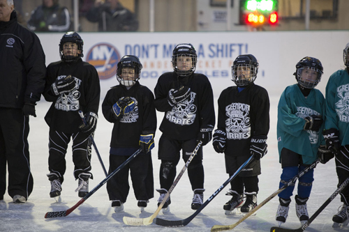 KATHARINE SCHROEDER | The Greenport Pirates take to the ice at Mitchell Park for the National Anthem Saturday night.