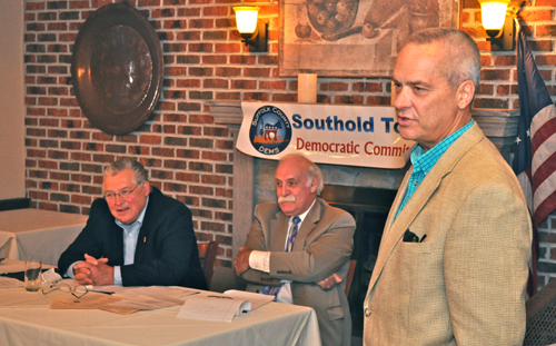 TIM KELLY FILE PHOTO | Republican Town Justice William Price addressing Southold's Democrats, including party Chairman Art Tillman (left) and Deputy Chairman Bob Meguin.