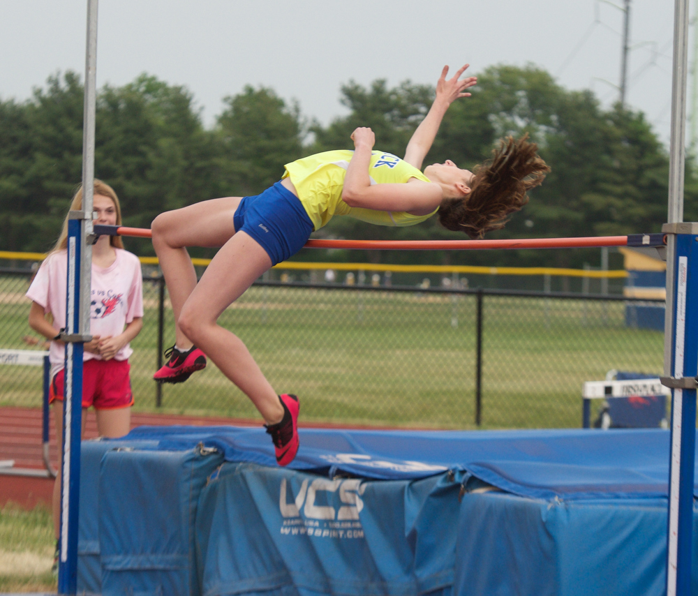 Sam Husak competes in the high jump.