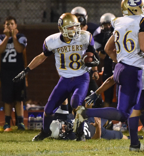 Greenport's Dominic Panetta looks for running room after an interception. (Credit: Robert O'Rourk)