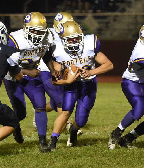 Late in the game, junior QB Dylan Marlborough gets some yardage on a quarterback keeper. (Credit: Robert O'Rourk)