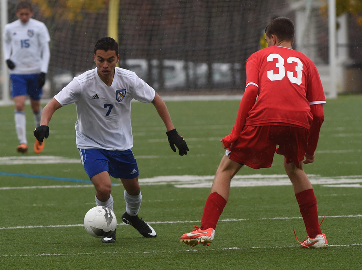 Mario Arreola of Mattituck moves the ball past Matt Almond. (Credit: Robert O'Rourk)