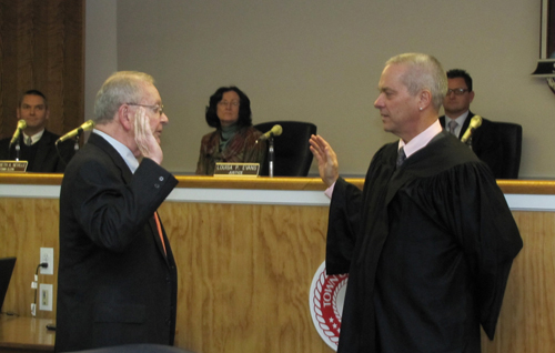 Southold Town Justice's Rudy Bruer, left, and William Price at Judge Bruer's swearing in ceremony in 2012. (Credit: Beth Young)