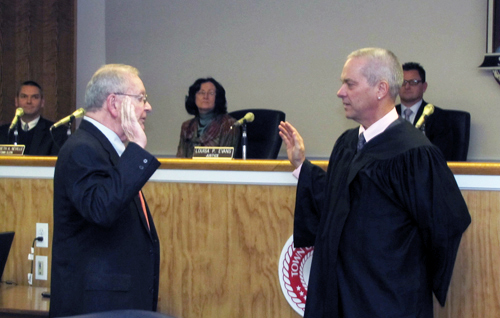 Southold Town Justices Rudolph Bruer, left, and William Price at a swearing in ceremony.