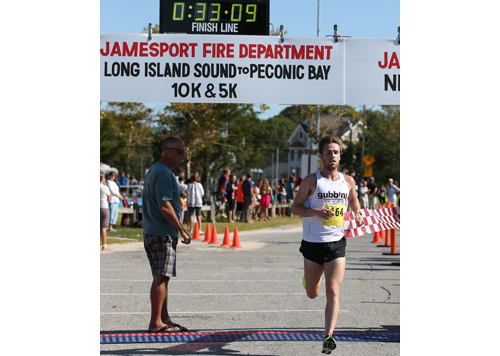 Kevin Harvey, a miler from Sag Harbor, never ran in the Sound to Bay 10K before, but that didn't prevent him from winning on Sunday morning. (Credit: Daniel De Mato)