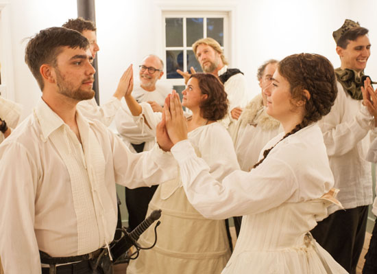 "Oliver Orr as Orlando and Elena Faverio as Rosalind and the cast of ""As You Like It"" during rehearsal. (Credit: Katharine Schroeder)"