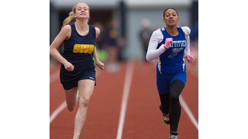 Shoreham-Wading River's Courtney Clasen, left, leaned forward at the finish line to nip Mattituck's Desirae Hubbard by 1/10th of a second in the 100 meters. (Credit: Garret Meade).