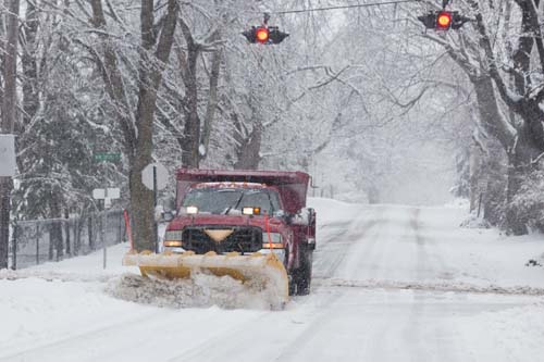 A Southold snow plow out in a February 2014 storm. (Credit: Katharine Schroeder, file)