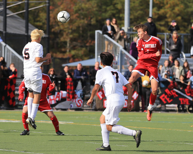 Southold's Joseph Silvestro  heads the ball toward Pierson's Ariel Quiros  during Southold's 1-0 loss to Pierson in the Class C finals at Diamond in the Pines in Coram Saturday. (Credit: Daniel De Mato photos)