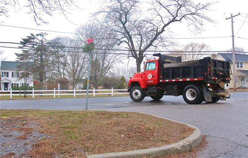 A highway department truck turns onto Main Road in January. (Credit: Barbaraellen Koch, file)