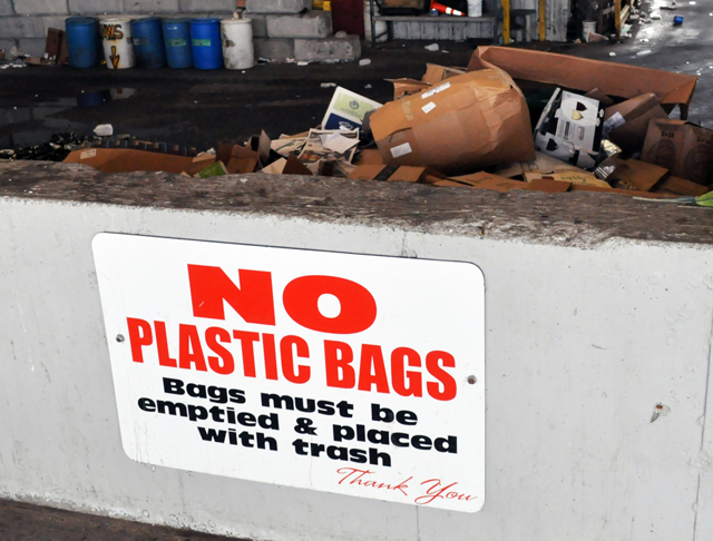 While signs urging residents not to include plastic bags with recyclables are clearly visible at the Southold Town Transfer Station on Cox Lane, residents who use private carters might not be getting this important message. (Credit: Grant Parpan)