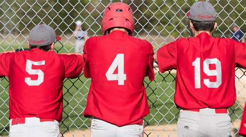 Southold's Sean Moran (5), Pat McFarland (4) and Noah Mina (19) get an up-close view of the game action Thursday when the First Settlers won the League IX championship outright. (Credit: Katharine Schroeder)