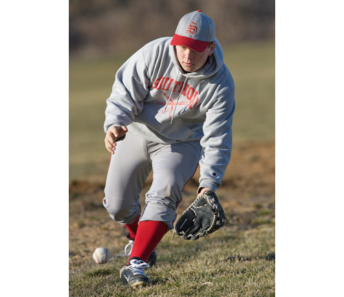 GARRET MEADE PHOTO | Alex Poliwoda, properly bundled up for the cold weather, during a fielding drill at Southold's first preseason practice.
