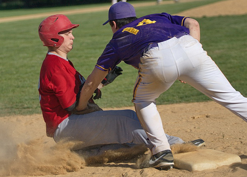 GARRET MEADE PHOTO | Southold's Dillon Engels is tagged out by Greenport's Matt Drinkwater while trying to steal third base in the fifth inning.