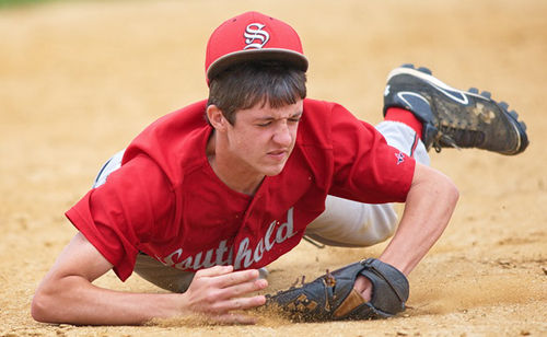 GARRET MEADE PHOTO | Southold shortstop Noah Mina lunging to his right for a sharp grounder that shot by him.