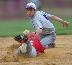 GARRET MEADE PHOTO | Port Jefferson second baseman Ben Kluender tagging out Southold's Sean Moran on an attempted steal in the third inning.