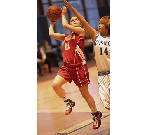 GARRET MEADE PHOTO | Justina Babcock of Southold attempting a layup while The Ross Schools Asuko Saito defends.