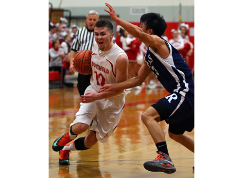 DANIEL DE MATO PHOTO | Liam Walker of Southold drives to the basket as Ross' Jiahni Guo tries to stop him.
