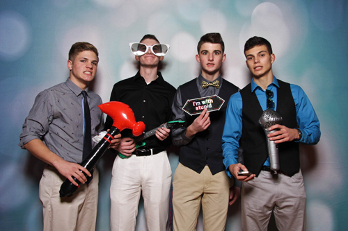 From left, Southold High School treasurer Zach Elillis, vice president Thomas Messana, secretary Jack Dunne, and president Christopher Buono in a photo booth picture taken at a semi-formal dance that included seniors from neighboring districts.