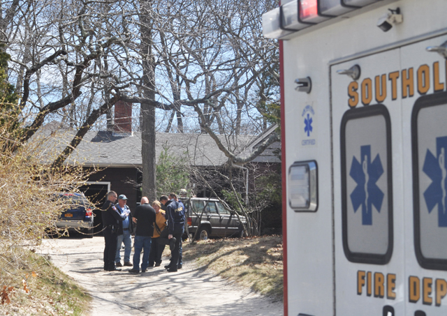 Southold fire chief Peggy Killian meets with Suffolk arson squad investigators as they arrive on the scene of a fatal house fire in Southold Wednesday. (Credit: Grant Parpan photos)