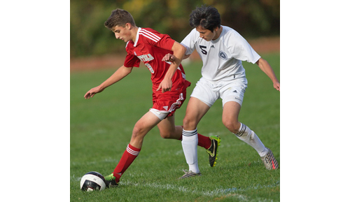 GARRET MEADE PHOTO | Southold's Jack Dunne, left, tries to ward off Stony Brook's Jason Lee while maintaining possession of the ball.