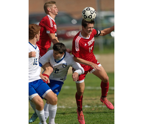Southold's Noah Mina gets his head on the ball amid a crowd of players. (Credit: Garret Meade)