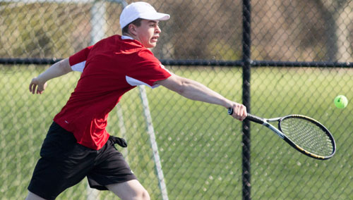 One of Southold/Greenport's first doubles players, Aidan Vandenburgh, reaching for a backhand during Tuesday's match against Eastport/South Manor. (Credit: Katharine Schroeder)