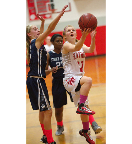 GARRET MEADE FILE PHOTO | One of Southold/Greenport's seven seniors, Justina Babcock, looks for room to shoot as Stony Brook's Annie Skorobohaty blocks her path.