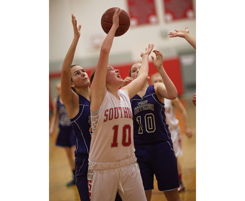 GARRET MEADE PHOTO | Southold/Greenport's Kathleen Tuthill, flanked by Port Jefferson's Caroline Biondo and Courtney Lewis (10), tries to find the ball during Friday night's game.