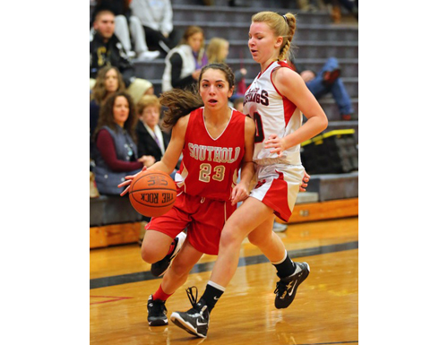 DANIEL DE MATO PHOTO | Southold/Greenport's Toni Esposito rounds Mount Sinai's Olivia Williams during Monday's non-league game.