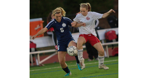 GARRET MEADE PHOTO | Stony Brook's Emma Lavery, left, and Southold/Greenport's Sophie Pickerell compete for the ball during the Suffolk County Class C final.