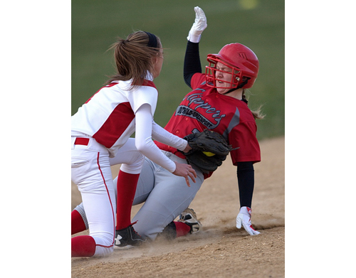 Center Moriches' Cassy Smith tags out Southold/Greenport's Heather Jarvis, who tried to steal second base in the fifth inning. (Credit: Garret Meade)