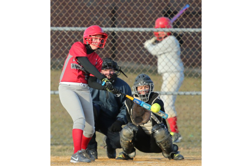 Stephanie Clark connecting for Southold/Greenport's second hit of the game. (Credit: Daniel De Mato)