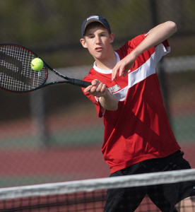GARRET MEADE PHOTO | Gary Prieto of Southold/Greenport playing at the net during his second singles match against Caleb Reed of Hampton Bays.